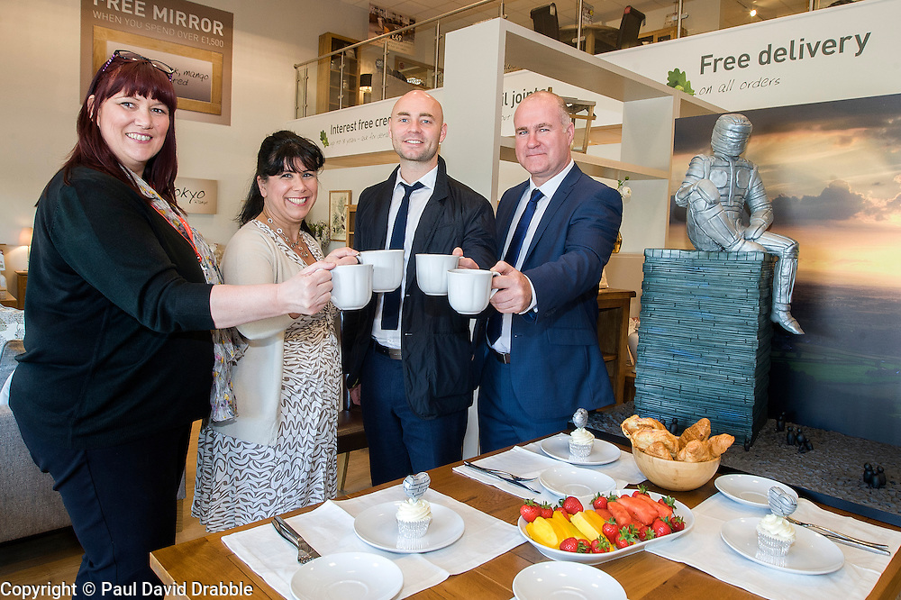 Left to right Rotherham Hospice Fundraising Team Leader Anne Giblin, Cake Artist Rose Dummer Events Fundraiser Ash Corker and Oak Furniture Land Rotherham Store Manager Jez Groom  enjoy a Celebration Breakfast with Man of Steel at the opening of the Oak Furniture Land Rotherham Store. The cake will be donated to Rotherham Hospice who will use it to help raise funds<br /> <br /> 3 June 2015<br />  Image &copy; Paul David Drabble <br />  www.pauldaviddrabble.co.uk