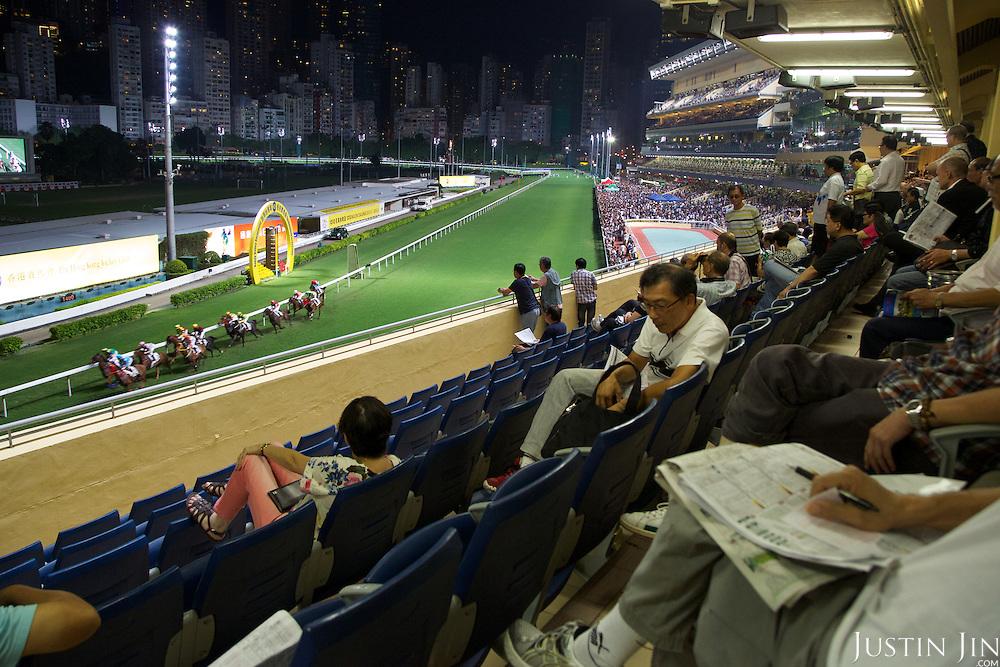 Spectators at the Hong Kong Jockey Club's Happy Valley racecourse.