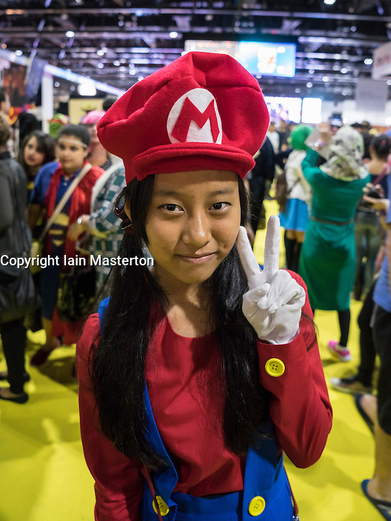 Dubai, April 4th 2014; Girl dressed as Super Mario at the 2014 Middle East Film and Comic Con at World Trade Centre in Dubai United Arab Emirates