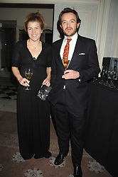 AMBER AIKENS and ALEXANDER MAVROS at a dinner to celebrate the launch of the Dom Ruinart 1998 vinatage champage at Claridge's, Brook Street, London W1 on 23rd April 2008.<br />