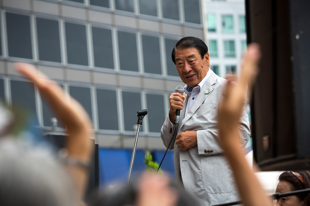 TOKYO, JAPAN - JULY 8 :  Masahiko Yamada politician of the Democratic Party of Japan (DPJ), delivers a campaign speech to support his party candidate Yohei Miyake during the 2016 Upper House election campaign outside of Shinjuku Station, Tokyo, Japan, on July 8, 2016. The July 10, 2016 Upper house election is the first nation-wide election in Japan after government law changes its voting age from 20 years old to 18 years old.  (Photo by Richard Atrero de Guzman/NUR Photo)