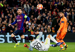 BARCELONA, March 14, 2019  Lyon's goalkeeper Mathieu Gorgelin (C) defends a goal from FC Barcelona's Lionel Messi (L) during the UEFA Champions League match between Spanish team FC Barcelona and French team Lyon in Barcelona, Spain, on March 13, 2019. Barcelona won 5-1 and advanced to the quarterfinals. (Credit Image: © Joan Gosa/Xinhua via ZUMA Wire)