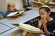 Young boys studying the Torah in a school in the Jewish community of Hebron. Some 600 Jews live in the heart of the old city surrounded by over 160,000 Palestinian inhabitants.<br /> Hebron, Israel. 01/11/2007
