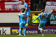Thomas Kennedy of Barnsley (rear) celebrates scoring his team's second goal to make it 0-2, with team mates, during the Sky Bet Championship match at The Valley, London<br /> Picture by David Horn/Focus Images Ltd +44 7545 970036<br /> 15/04/2014