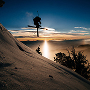 Teton Brown grabs air as the sun rises over the Teton backcountry.