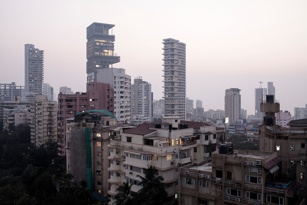 INDIA, MUMBAI 2014<br /><br />In the business district Tardeo, the tallest inhabited India (Imperial Towers) was built in 2010 at the former location slums. The people were relocated just opposite the spectacular twin towers, in the colony of New Jaiphalwadi. A simple and low wall separates the extremes of Indian society. The coming months, a new site on the same model, will result in the erection of a 400m tower.<br /><br />Mumbai &quot;slum rehabilitation&quot; project forced people to move to places like Lallubhai Compound in Mankhurd: <br /> 100 building central cluster rises ominously, each building separated from the other by a small corridor full of garbage,.Welcome to Mumbai's slum resettlement housing projects, the future of the big metropolis, Vertical Slums @Giuliodisturco