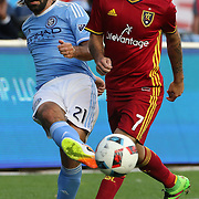 NEW YORK, NEW YORK - June 02:  Andrea Pirlo #21 of New York City FC is challenged by Juan Martinez #7 of Real Salt Lake in action during the NYCFC Vs Real Salt Lake regular season MLS game at Yankee Stadium on June 02, 2016 in New York City. (Photo by Tim Clayton/Corbis via Getty Images)