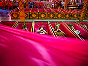 "30 DECEMBER 2017 - BANG KRUAI, NONTHABURI, THAILAND:  People lie in a coffin a resurrection ceremony at Wat Ta Khien, about 45 minutes from Bangkok in Nonthaburi province. The temple is famous for the ""floating market"" on the canal that runs past the temple and for the ""resurrection ceremonies"" conducted by monks at the temple. People lie in a coffin and ritualistically die before being reborn. Adherents believe it will improve their karma and help make up for past sins. PHOTO BY JACK KURTZ"
