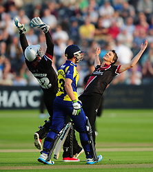 Benny Howell of Gloucestershire leaves the field dejected as Max Waller of Somerset (r) and Craig Kieswetter of Somerset celebrate his wicket - Photo mandatory by-line: Dan Mullan/JMP - 07966 386802 - 16/05/2014 - SPORT - CRICKET - County Cricket Ground - Gloucester Cricket v Somerset Cricket - T20