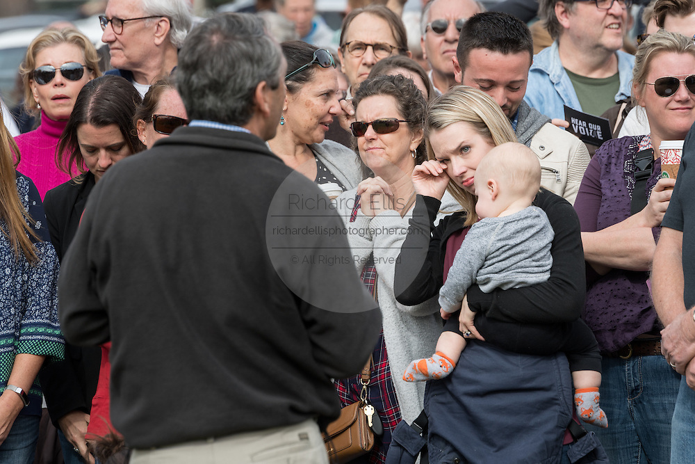 U.S. Rep. Mark Sanford answers an emotional question of a young mother on health care for her son during a second town hall meeting held on a football field after hundreds of constituents overwhelmed the first scheduled event February 18, 2017 in Mount Pleasant, South Carolina. Hundreds of concerned residents turned up for the meeting to address their opposition to President Donald Trump during a vocal meeting held by U.S. Rep. Mark Sanford and Senator Tim Scott.