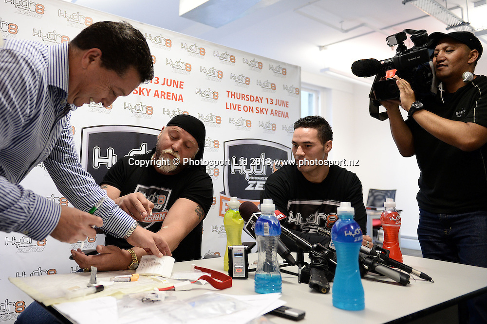 Joseph Parker and Francois Botha (L) are tested for drugs ahead of Thursday nights Hydr8 Zero Explosion boxing event. Duco Events offices, Auckland. Tuesday 11 June 2013. Photo: Andrew Cornaga/photosport.co.nz