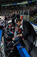 KELOWNA, CANADA - SEPTEMBER 24: Assistant coach Travis Crickard goes over a play on the bench against the Kamloops Blazers on September 24, 2016 at Prospera Place in Kelowna, British Columbia, Canada.  (Photo by Marissa Baecker/Shoot the Breeze)  *** Local Caption *** Travis Crickard;