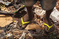 Idris' feet in rubbish