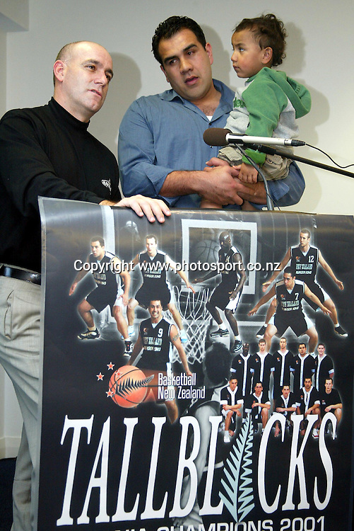 Pero Cameron with son Flynn and coach Tab Baldwin at a Tall Blacks press conference at the Spencer on Byron Hotel, Takapuna, Auckland, 16 May, 2002. Photo: Chris Skelton/PHOTOSPORT<br /><br /><br /><br />048300 *** Local Caption ***