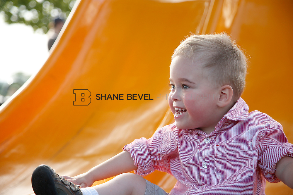 5/28/15 6:05:34 PM -- Miracle Miles and his family pose for portraits and play at the QuikTrip park for the 2015 Saint Francis Health System advertising campaign. <br /> <br /> Photo by Shane Bevel