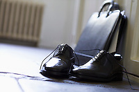 Dress Shoes and briefcase on domestic Hallway floor close up