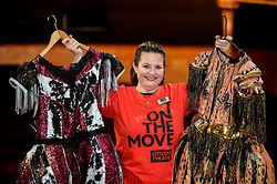 Pictured: Head of Development Kirstie Cusick with two of the flamboyant stage costumes up for auction.<br /> <br /> Glasgow's Citizens Theatre auctioned off some of it's most famous props and costumes, as it prepares for a 19 million GBP refurbishment.<br /> <br /> © Dave Johnston / EEm