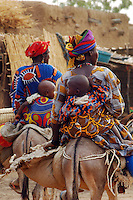 BURKINA FASO, Gorom-Gorom, 2007. After all day at Gorom-Gorom's Thursday market, around four in the afternoon Bella women begin the long ride home.