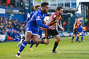 Oldham Athletic forward Aaron Amadi-Holloway (10) in a race with Bradford City midfielder Romain Vincelot (6)  during the EFL Sky Bet League 1 match between Oldham Athletic and Bradford City at Boundary Park, Oldham, England on 28 January 2017. Photo by Simon Davies.