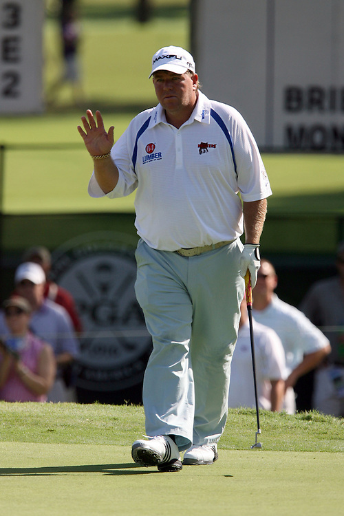 09 August 2007: John Daly salutes the gallery after saving par on the 3rd hole during the first round of the 89th PGA Championship at Southern Hills Country Club in Tulsa, OK.