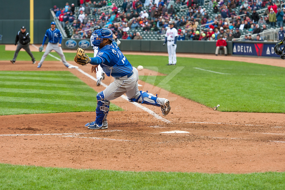 Salvador Perez #13 of the Kansas City Royals can't handle a throw home that lead to the go-ahead run scoring for the Minnesota Twins in the 8th inning on April 13, 2014 at Target Field in Minneapolis, Minnesota.  The Twins defeated the Royals 4 to 3.  Photo by Ben Krause