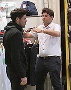 01.MARCH.2014. ESSEX<br /> <br /> CODE - MAG<br /> <br /> TOWIES JAMES 'ARG' ARGENT SEEN BUYING A NEW BLUE JUMPER AHEAD OF TOWIE FILMING IN EPPING, ESSEX. JAMES TOOK BEST MATE TOM PEARCE ALONG AND PICKED OUT A &pound;260.00 JUMPER BUT FORGOT TO REMOVE THE SECURITY TAG AND SET OFF THE STORE ALARMS. JAMES WAS ALSO SEEN RIPPING UP HIS OLD RED JUMPER WITH HELP FROM TOM AND CHUCKED IT IN THE BIN, THEY THEN WENT TO GREGS FOR A SAUSAGE ROLL OR TOO. BUT BEFORE HEADING BACK TO FILMING JAMES AND TOM WERE STOPPED IN THE STREET BY A FAN WHO WANTED TO TAKE A PICTURE OF THEM WITH HER LITTLE DOG<br /> <br /> BYLINE: EDBIMAGEARCHIVE.CO.UK<br /> <br /> *THIS IMAGE IS STRICTLY FOR UK NEWSPAPERS AND MAGAZINES ONLY*<br /> *FOR WORLD WIDE SALES AND WEB USE PLEASE CONTACT EDBIMAGEARCHIVE - 0208 954 5968*