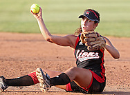 Linn-Mar's Kelsey Duggan (12) throws to first from a seated position for an out during the softball game between Cedar Rapids Washington and Linn-Mar at Oak Ridge Middle School in Marion on Thursday, June 20, 2013. The Lions defeated the Warriors 7-6 in 9 innings.