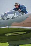 A Supermarine Spitfire is prepared - Duxford Battle of Britain Air Show taking place during IWM (Imperial War Museum) Duxford's centenary year. Duxford's principle role as a Second World War fighter station is celebrated at the Battle of Britain Air Show by more than 40 historic aircraft taking to the skies.