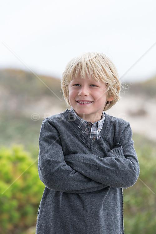 little blond boy on the beach