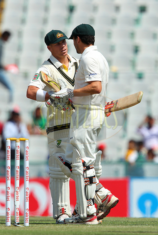 David Warner of Australia congratulates Ed Cowan of Australia on his fifty during day 2 of the 3rd Airtel Test Match between India and Australia held at the PCA Stadium, Mohal, India on the 15th March 2013..Photo by Ron Gaunt/BCCI/SPORTZPICS ..Use of this image is subject to the terms and conditions as outlined by the BCCI. These terms can be found by following this link:..http://www.sportzpics.co.za/image/I0000SoRagM2cIEc