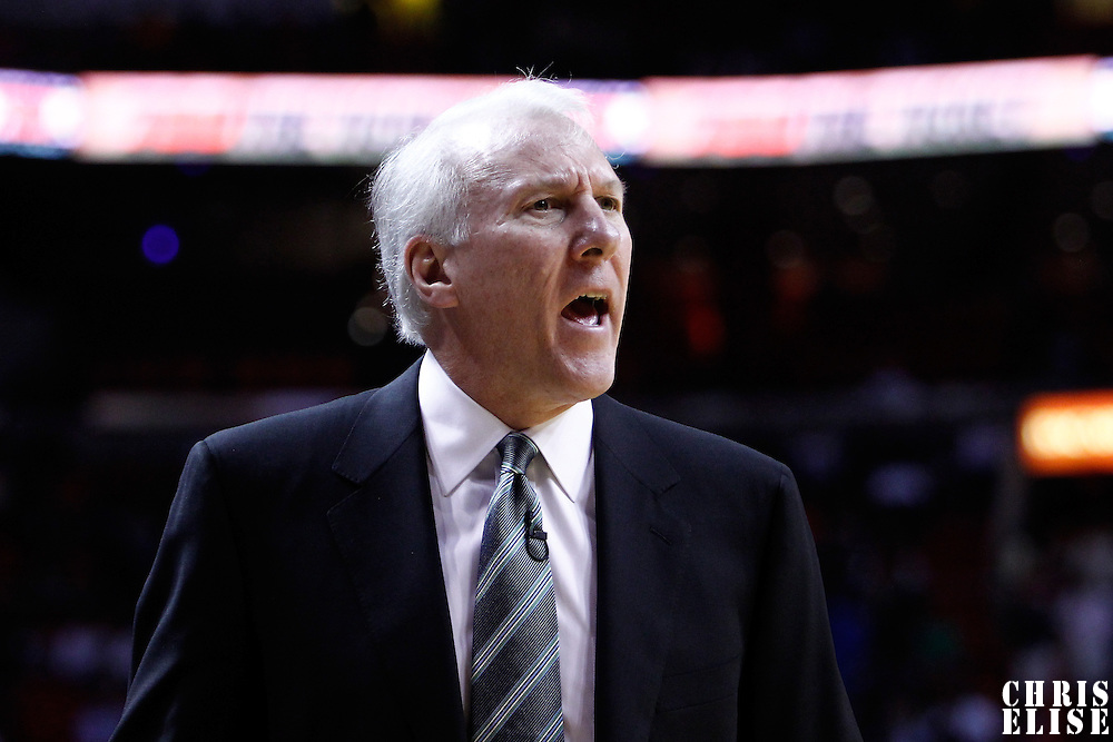 14 March 2011: San Antonio Spurs head coach Greg Popovich reacts during the Miami Heat 110-80 victory over the San Antonio Spurs at the AmericanAirlines Arena, Miami, Florida, USA.