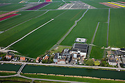 Nederland, Noord-Holland, Gemeente Koggenland, 28-04-2010; Oudendijk, cooperatieve melkfabriek Concordia (gesloten), POlder Beschoot in de achtergrond. .Cooperative dairy Concordia (closed).luchtfoto (toeslag), aerial photo (additional fee required).foto/photo Siebe Swart