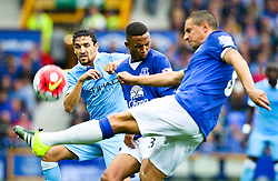 Everton's Phil Jagielka clears the ball ahead of Brendan Galloway and Jesus Navas of Manchester City  - Mandatory byline: Matt McNulty/JMP - 07966386802 - 23/08/2015 - FOOTBALL - Goodison Park -Everton,England - Everton v Manchester City - Barclays Premier League