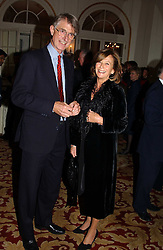 MR CHRISTOPHER MARTIN and VIRGINIA ACLAND at a reception following a charity carol service in aid of the Mental Health Foundation attended by HRH Princess Michael of Kent and held at the Hype Park Mandarin Oriental Hotel, Knightsbridge, London on 30th November 2004.<br /><br />NON EXCLUSIVE - WORLD RIGHTS
