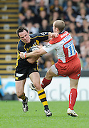 """Wycombe, GREAT BRITAIN, Wasps' Fraser WATERS, pushes through James SIMPSON-DANIEL""""s tackle, during the Guinness Premiership game, London Wasps vs Gloucester Rugby, Sun. 04.05.2008 [Mandatory Credit Peter Spurrier/Intersport Images]"""