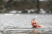 UNITED KINGDOM, London: 01 March 2018 Incredibly brave individuals go for what must be a shockingly cold swim at the Highgate Men's Bathing Pond in Hampstead Heath, London this morning. The cold weather and snow is set continue as Storm Emma makes it's way across the country. Rick Findler / Story Picture Agency