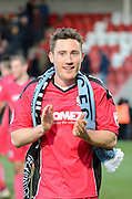 Chris Kinnear celebrates the victory during the The FA Cup match between Cheltenham Town and Dover Athletic at Whaddon Road, Cheltenham, England on 7 December 2014.