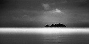 Tarahiki Island, as seen from Opopo Bay, Waiheke Island.  Unusual weather and light.