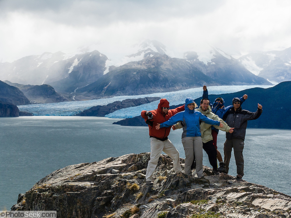 Steady 50-miles-per-hour winds blast hikers near Grey Glacier in Torres del Paine National Park, Chile. The foot of South America is known as Patagonia, a name derived from coastal giants, Patagão or Patagoni, who were reported by Magellan's 1520s voyage circumnavigating the world and were actually Tehuelche native people who averaged 25 cm (or 10 inches) taller than the Spaniards. For licensing options, please inquire.