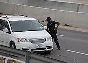 April 2, 2014 - Fort Hood, TX, USA - <br /> <br /> Gunman Kills 3, Wounds 16 at Fort Hood Army Base<br /> <br /> A police officer checks drivers' IDs outside the main gate at Fort Hood, Texas, after a shooting at the Army base. An Iraq War veteran being treated for mental illness opened fire Wednesday on fellow service members at the Fort Hood military base, killing three people and wounding 16 before committing suicide at the same post where more than a dozen people were slain in a 2009 attack. <br /> ©Exclusivepix