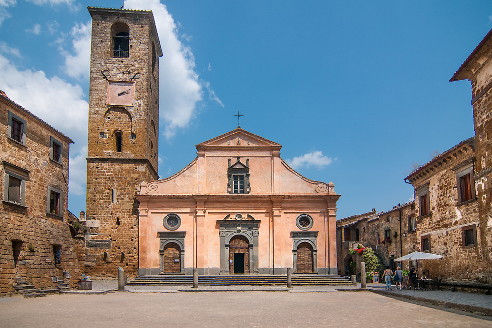 The church of San Donato in the village of Civita di Bagnoregio.<br /> Civita di Bagnoregio is a town in the Province of Viterbo in central Italy, a suburb of the comune of Bagnoregio, 1 kilometre (0.6 mi) east from it. It is about 120 kilometres (75 mi) north of Rome. Civita was founded by Etruscans more than 2,500 years ago. Bagnoregio continues as a small but prosperous town, while Civita became known in Italian as La citt&agrave; che muore (&quot;The Dying Town&quot;). Civita has only recently been experiencing a tourist revival. The population today varies from about 7 people in winter to more than 100 in summer.The town was placed on the World Monuments Fund's 2006 Watch List of the 100 Most Endangered Sites, because of threats it faces from erosion and unregulated tourism.