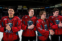 KELOWNA, CANADA - MARCH 16: Devin Steffler #4, Cayde Augustine #5, Kyle Crosbie #25 and Mark Liwiski #9 of the Kelowna Rockets liane up for the shirt off your back presentation after the OT wind against the Vancouver Giants on March 16, 2019 at Prospera Place in Kelowna, British Columbia, Canada.  (Photo by Marissa Baecker/Shoot the Breeze)