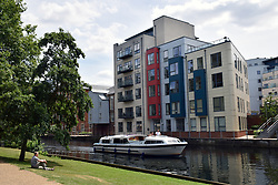 New housing developments on bank of River Wensum, Norwich UK 2017. On site of old Colman factory. Remains of city walls in foreground, Norwich UK 2017. On right, site of old Colman factory. Remains of city walls in foreground, Norwich UK 2017. On site of old Colman factory. Remains of city walls in foreground