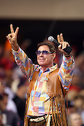 """ANAHEIM, CA - MAY 15:  Barry Williams, star of the former television series """"The Brady Bunch"""", gives the peace sign after singing Take Me Out to the Ball Game at retro night during the seventh inning stretch at the game between the Los Angeles Angels of Anaheim and the Chicago White Sox at Angel Stadium in Anaheim, California on May 15, 2008. The White Sox defeated the Angels 4-3. ©Paul Anthony Spinelli*** Local Caption *** Barry Williams"""
