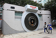 CHENGDU, CHINA - NOVEMBER 07: (CHINA OUT) <br /> <br /> Various Toilets In China<br /> <br /> Two citizens watch a camera-shaped public toilet in Shiqiaopu Street on February 7, 2014 in Chonqging, China. The World Toilet Day falls in November 19 each year and will kick off Thursday this year. <br /> ©Exclusivepix Media