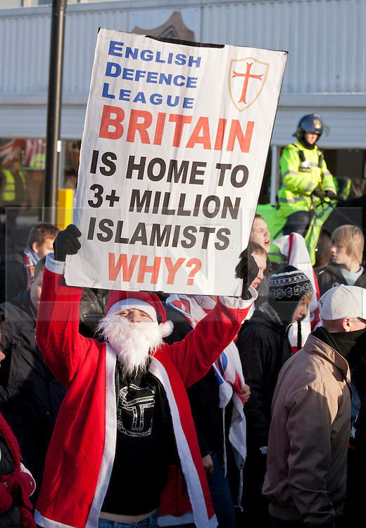 © under licence to London News Pictures 27/11/2010 today picture.The English Defence League held a National protest march through Nuneaton, Warwickshire earlier today. Police from forces as far away as Gloucestershire were called upon to contain the massed ranks of demonstraters. Pictured a protester dressed as Santa taking part in the march..Picture credit: Dave Warren/London News Pictures...