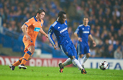 LONDON, ENGLAND - TUESDAY, SEPTEMBER 15th, 2009: Chelsea's Michael Essien and Porto's Cristian Rodriguez during the UEFA Champions League Group D match at Stamford Bridge. (Photo by Chris Brunskill/Propaganda)