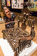 GONÇALO MABUNDA (MOZAMBICAN, BORN 1975) Weapon Throne I <br /> welded metal and decommissioned weapons£7,000-10,000<br />  - Bonhams previews works from its Africa Now sail - the first contemporary sale of African artists - and its Gutai and ZERO exhibition. In their offices on New Bond Street.