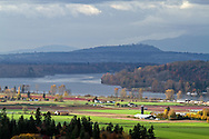View of Glen Valley farmland in Langley, the Fraser River, and Coquitlam/Burnaby Mountain beyond.  Photographed in the fall from the north end of Bradner Road in Abbotsford, British Columbia, Canada