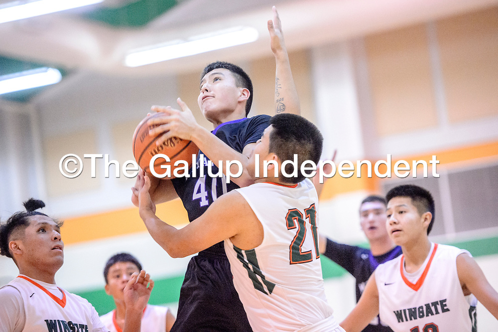 Miyamura Patriot Will Damon (40) attempts a layup under pressure from Wingate Bear Leon Alonzo (21) during the Wingate Holiday Classic basketball tournament championship at Wingate High School Saturday.